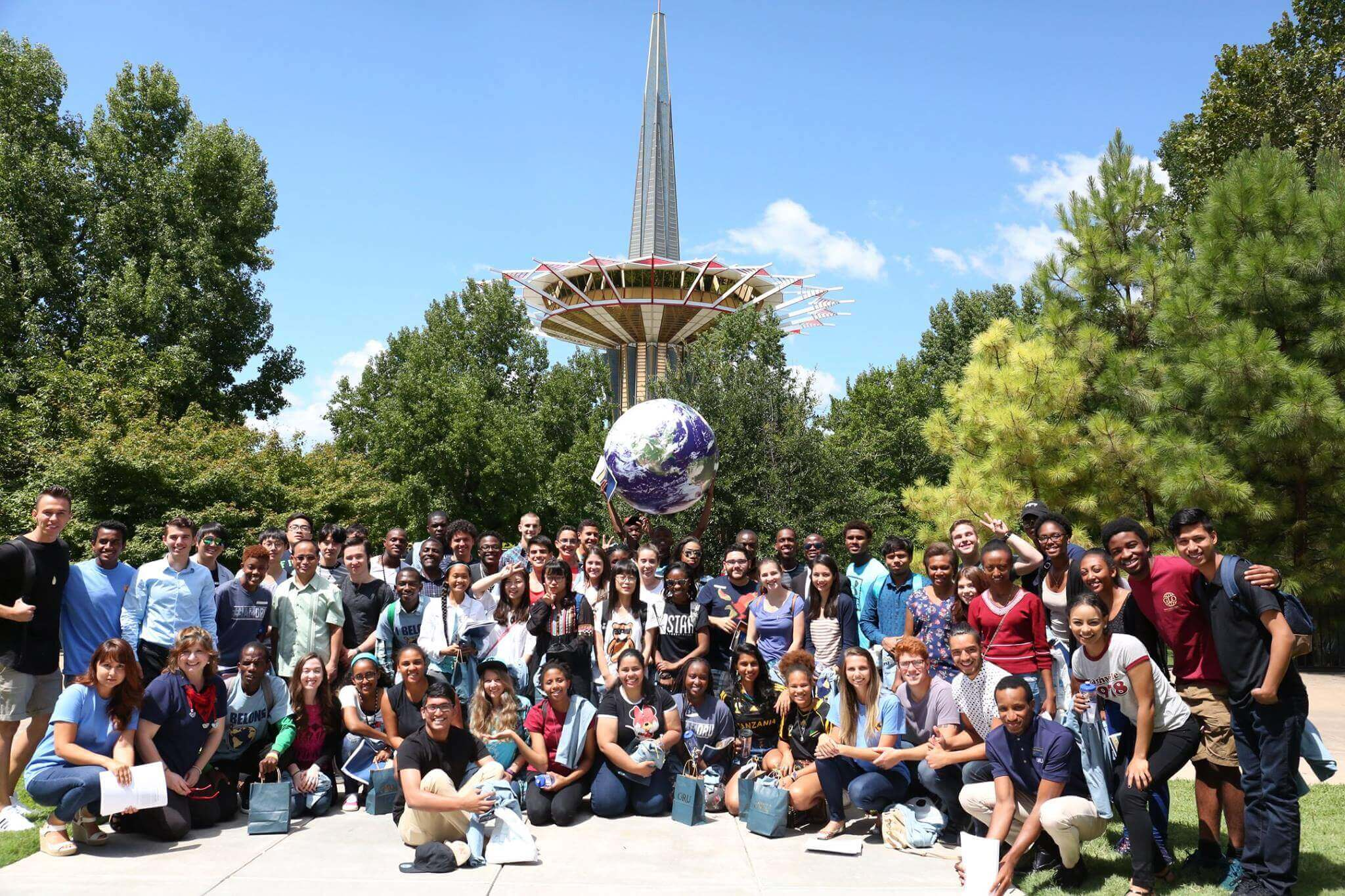 international students with globe