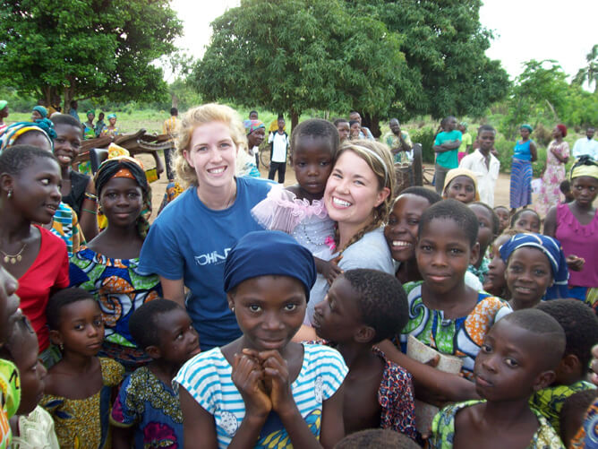 Student missionary surrounded by kids