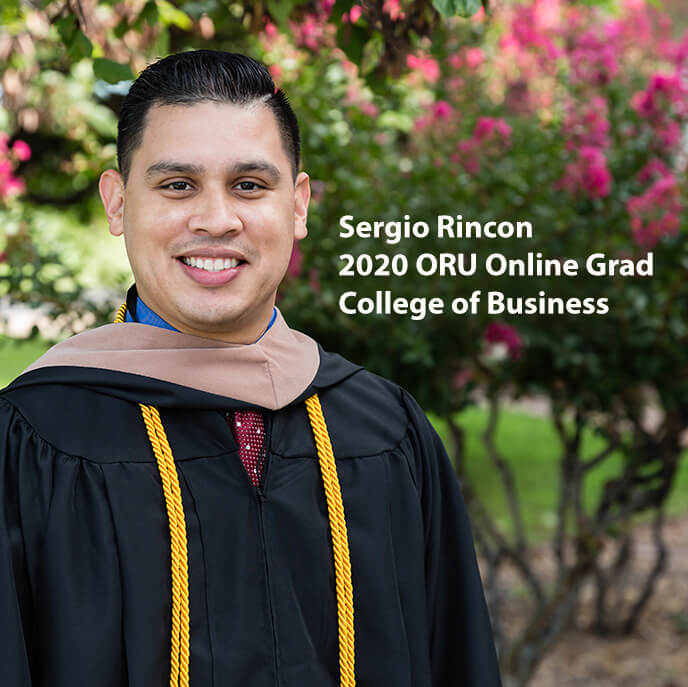 Online Graduate Sergio Rincon in Cap and Gown